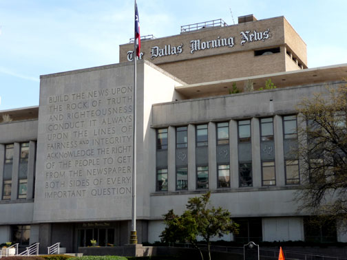 ... giant inscription on the wall of the dallas morning news building
