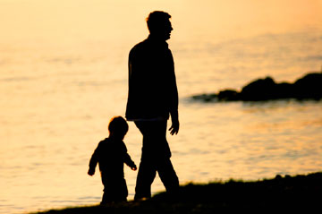 father son beach walking